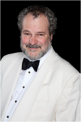 magician Johnny Ace Palmer in white tuxedo photo
